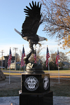 The bronze eagle statue sits atop a piece of granite which has been engraved with the logos of each of the U.S. military branches.